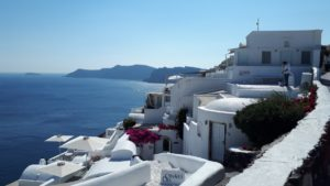 View of white buildings, sea and caldera islands in Oia Santorini