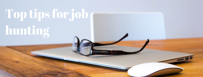 Job hunting: Table and chair with laptop, mouse and a pair of glasses