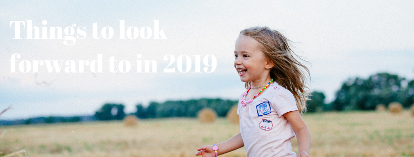 "Things I'm looking forward to in 2019 - young smiling girl running through field with text ""things to look forward to in 2019"""