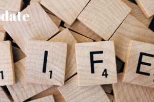 "It's good to talk : Wooden scrabble tiles spelling life with text ""a life update"""